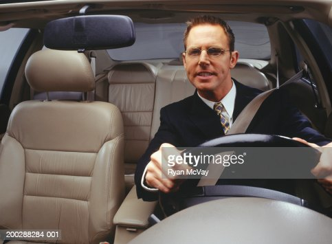 Businessman driving car : Stock Photo