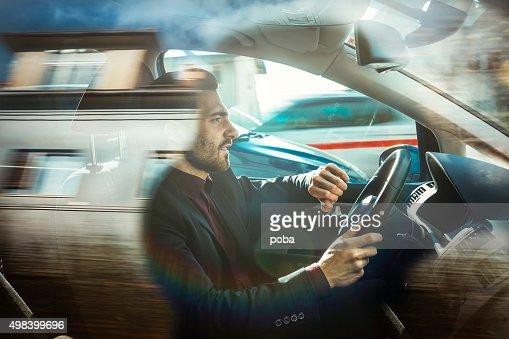 Businessman driving car : Stock Photo