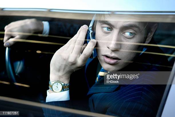 Businessman Driving Car Talking on Cellphone