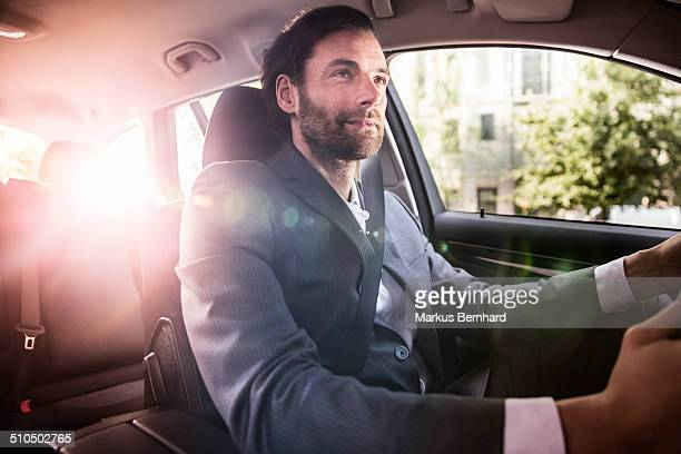 Businessman driving his car