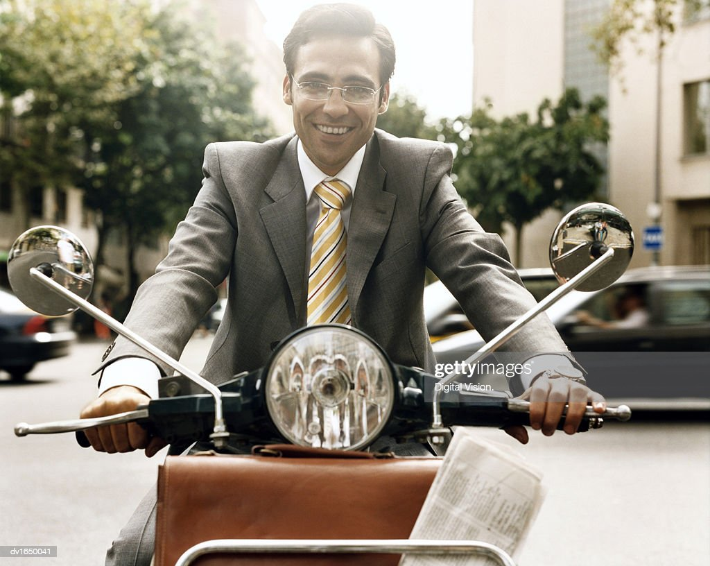 Businessman Driving His Moped, Barcelona, Spain : Stock Photo