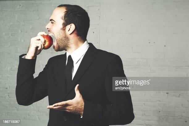 Businessman eating an apple