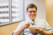 Businessman eating cereal