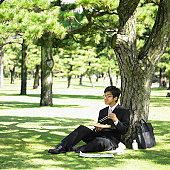 Businessman eating lunch in park