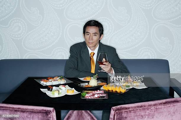Businessman Eating Sushi Dinner