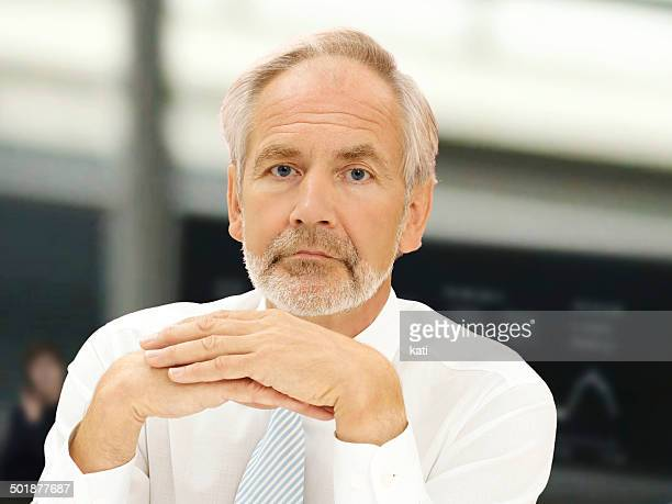 Businessman, enior, thoughtful or worried expression at the stock exchange