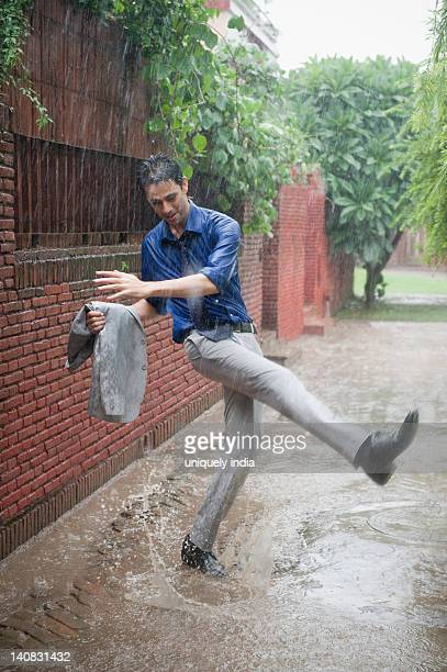 Businessman enjoying rain