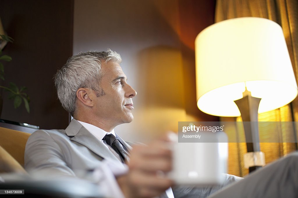 Businessman enjoys a cup of coffee. : Stock Photo