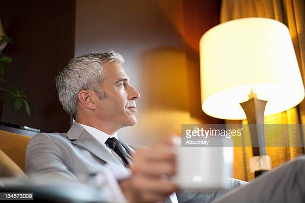 Businessman enjoys a cup of coffee.