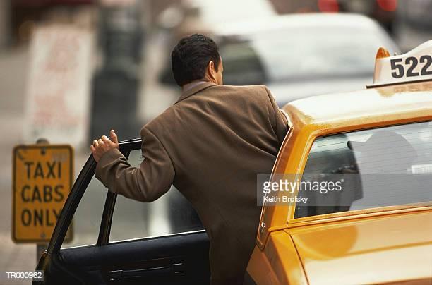 Businessman Entering a Taxi