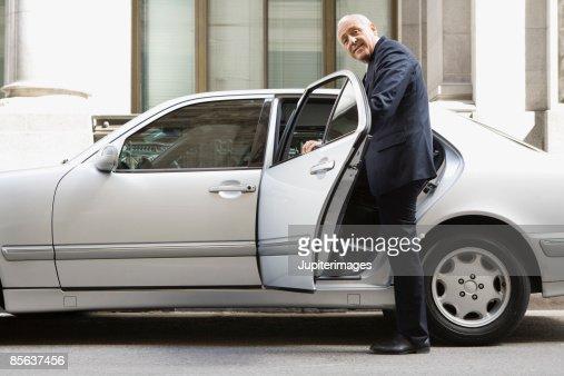 Businessman entering car