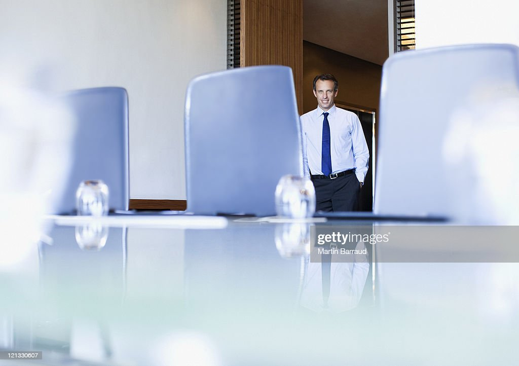 Businessman entering conference room : Stock Photo