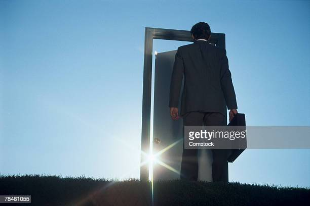 Businessman entering door outdoors