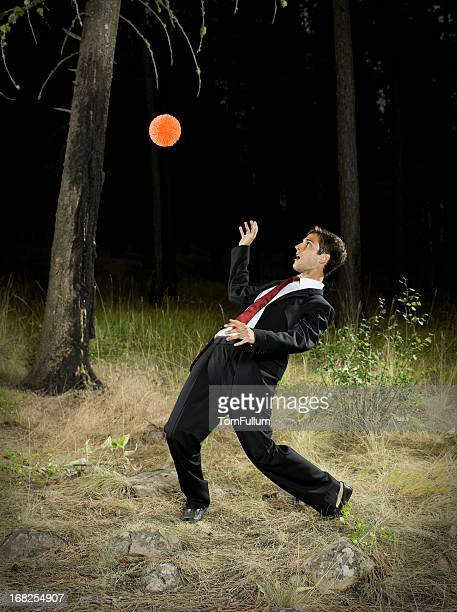 Businessman Evading Ball