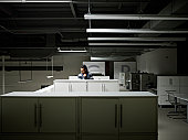 Businessman examining documents in empty office