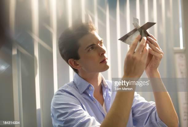 Businessman examining model in office