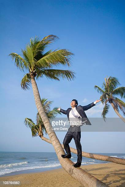 Businessman excited to be on the beach