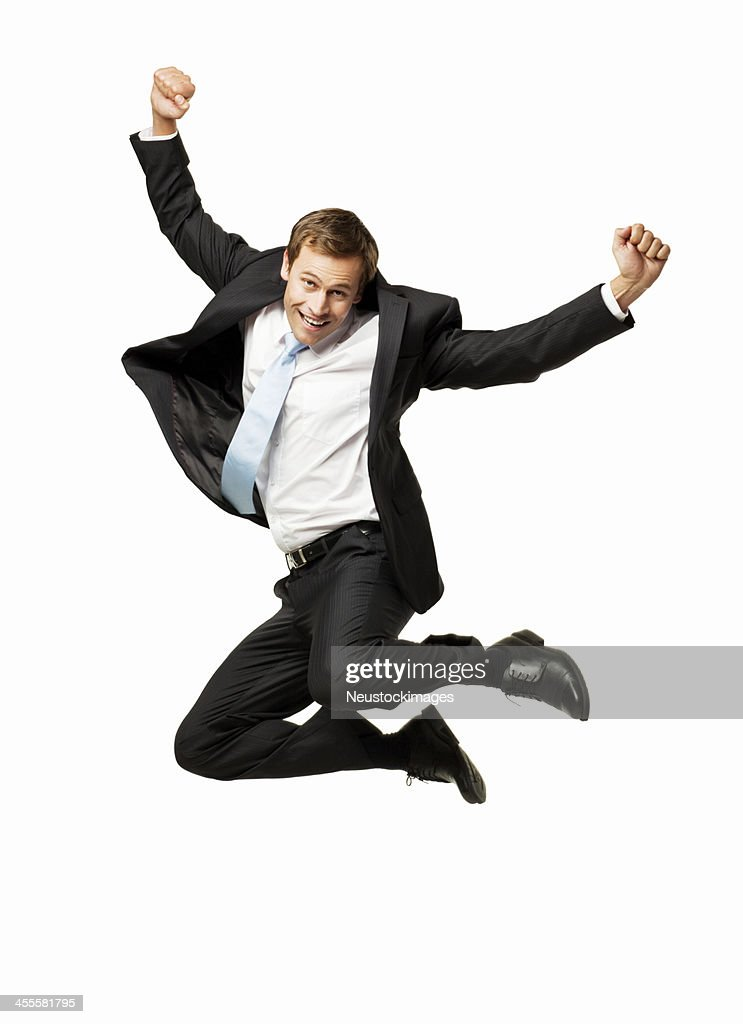Businessman Excitedly Jumping in the Air - Isolated