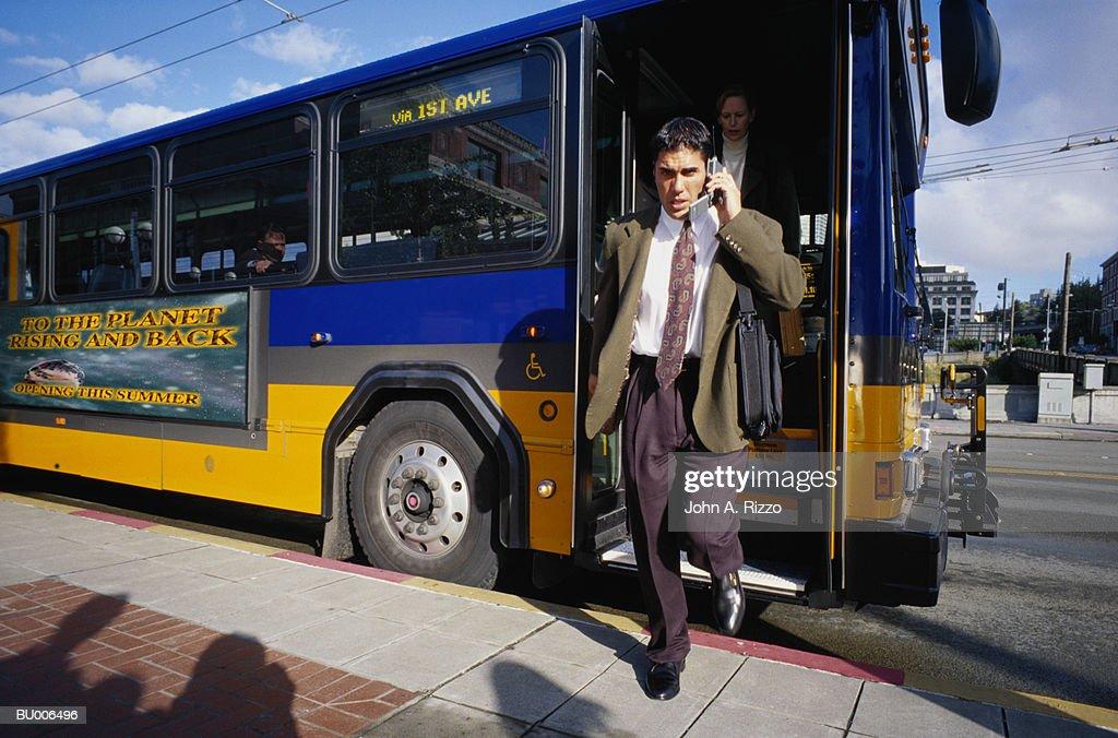 Businessman Exiting Bus : Stock Photo