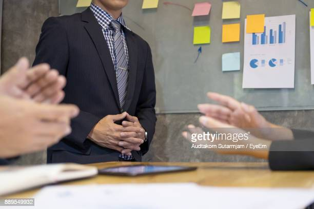 Businessman Explaining Colleagues While Discussing In Meeting At Office