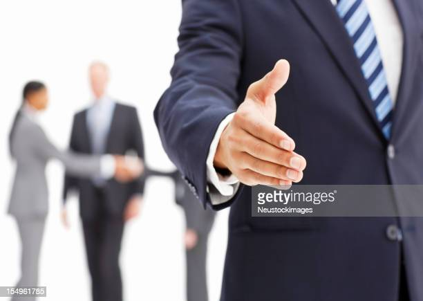 Businessman Extending a Hand In Greeting