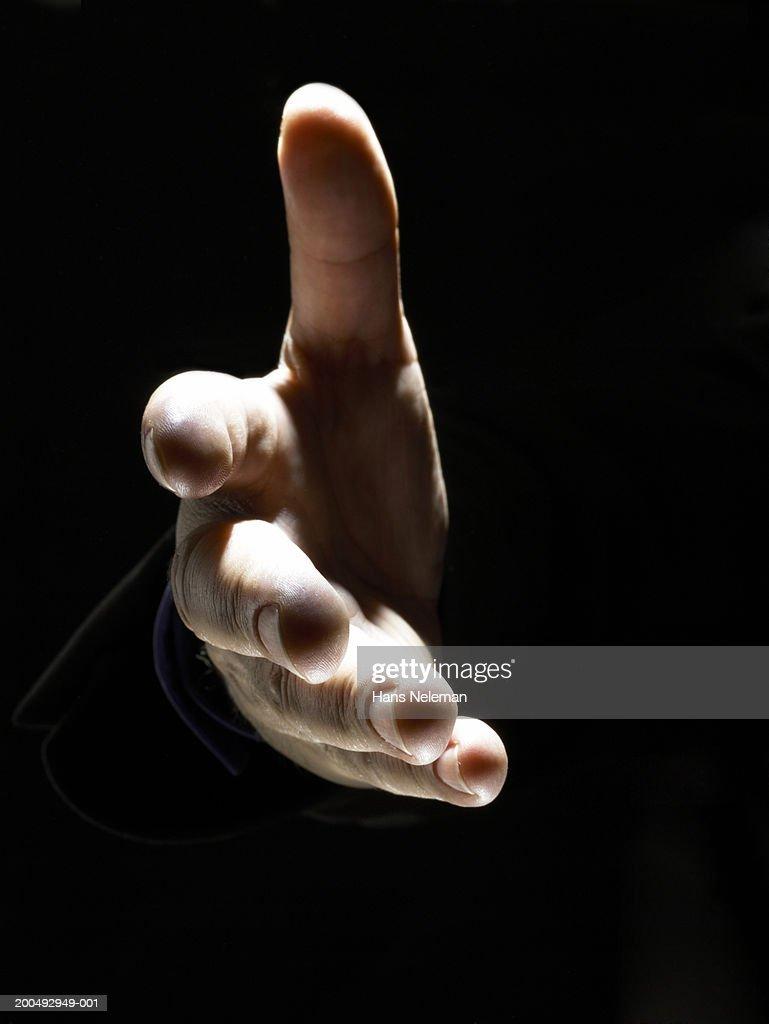 Businessman extending hand for handshake, close-up : Stock Photo