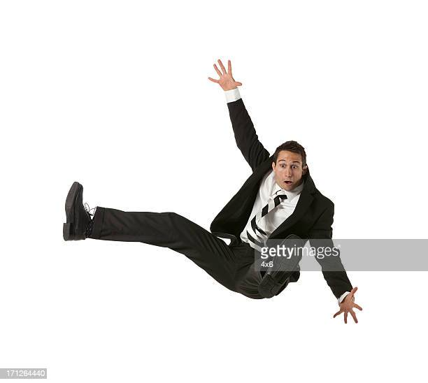 Businessman falling down