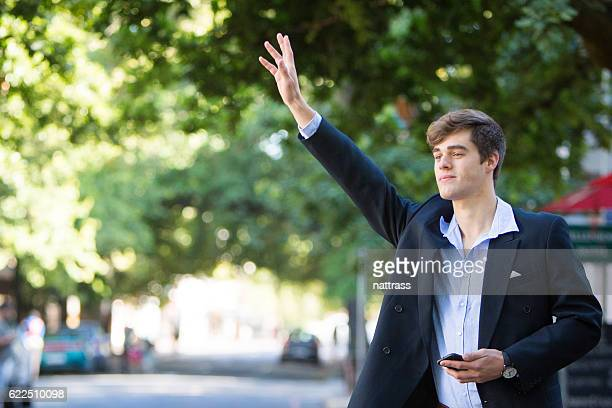 Businessman flagging down a taxi