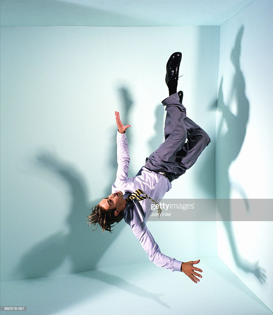 Businessman floating in mid-air : Stock Photo