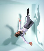 Businessman floating in mid-air
