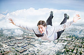 Businessman flying over city aerial view digital composite