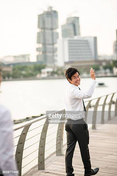 businessman friends on the city of Singapore