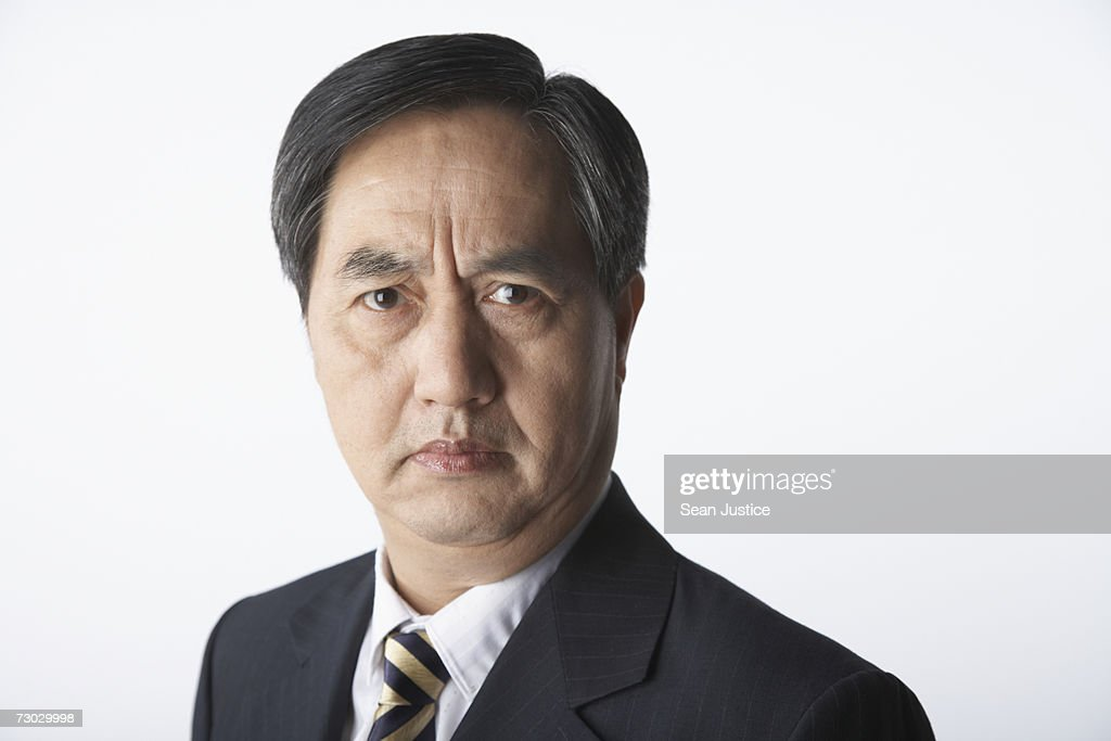 Businessman frowning, portrait : Stock Photo