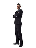Businessman with folded hands full length portrait isolated on white background