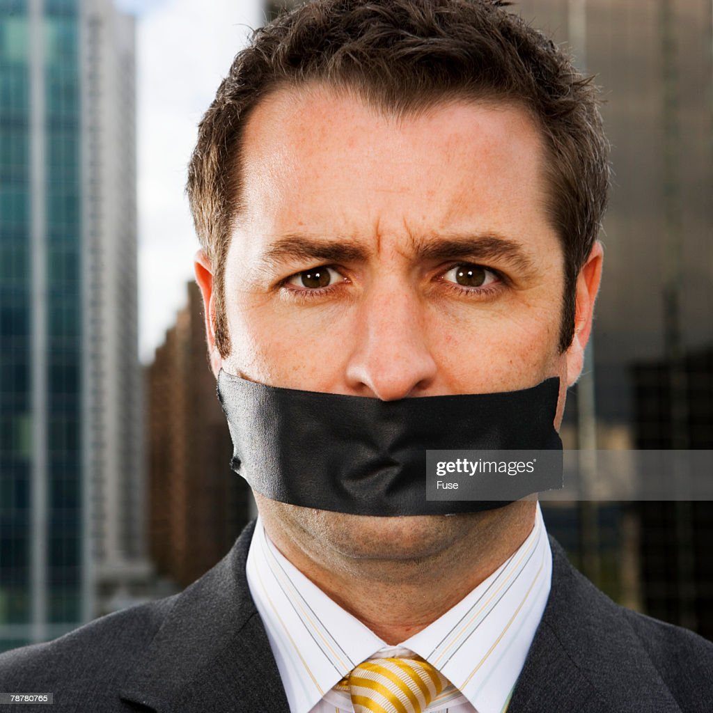 Businessman Gagged with Black Tape
