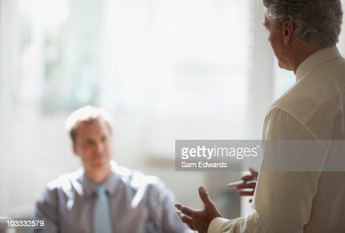 Businessman gesturing in meeting : Stock Photo