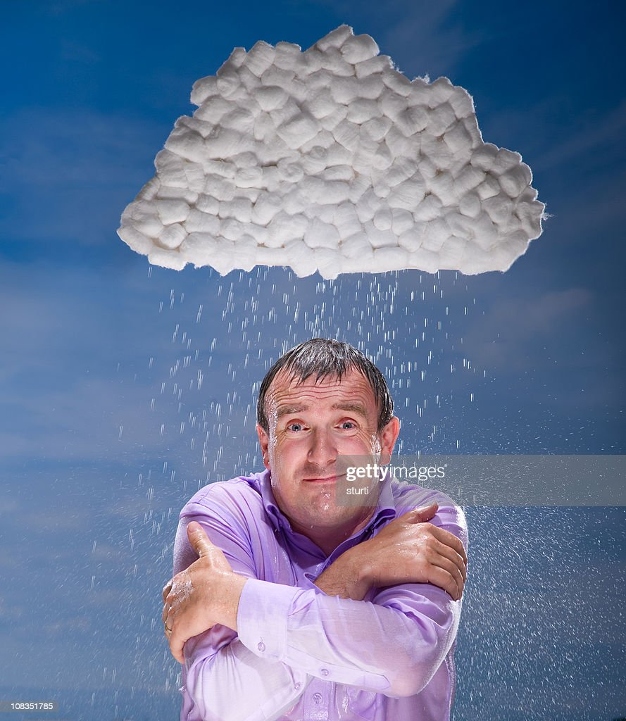 Businessman gets rained on by storm cloud