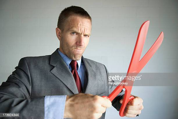 Businessman Gets Serious about Cutting Costs with Red Scissors