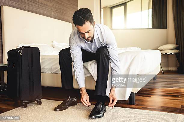 Businessman getting dressed in the morning