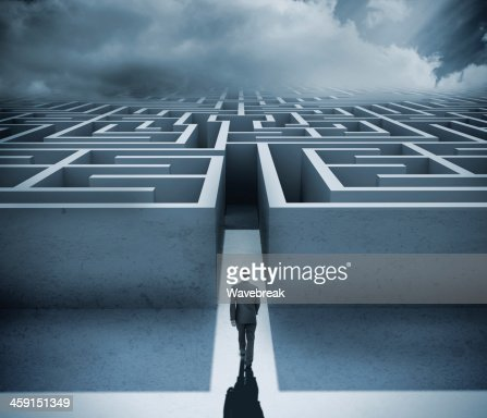Businessman getting in a maze