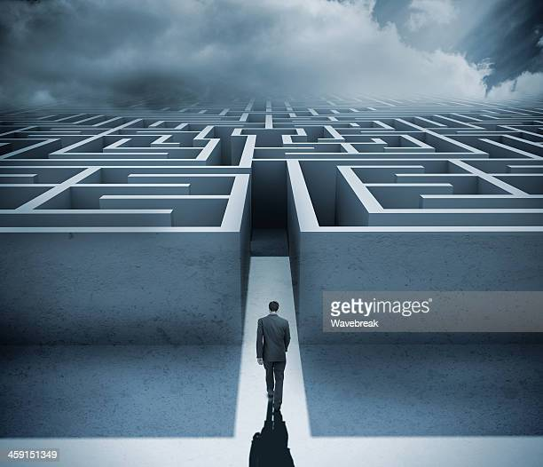 Businessman getting in a maze