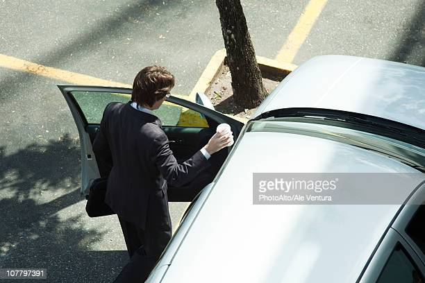 Businessman getting into car
