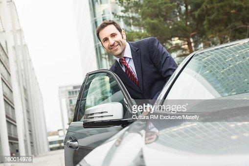 Businessman getting into car