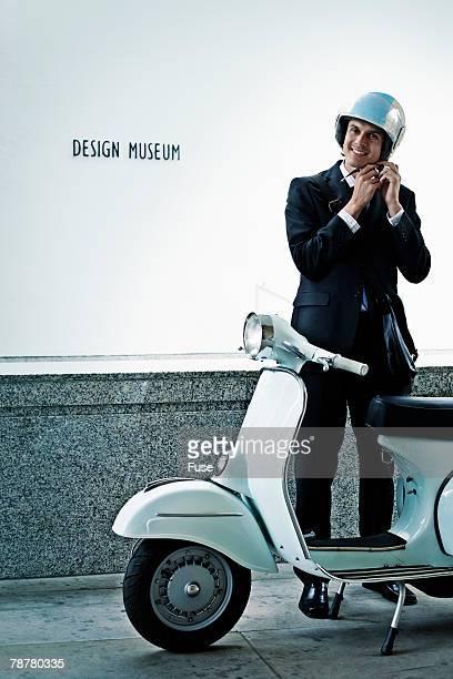 Businessman Getting on Motorscooter