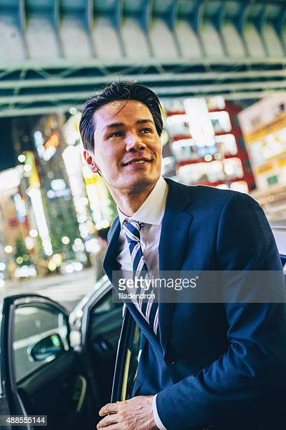 Businessman getting ou of a car