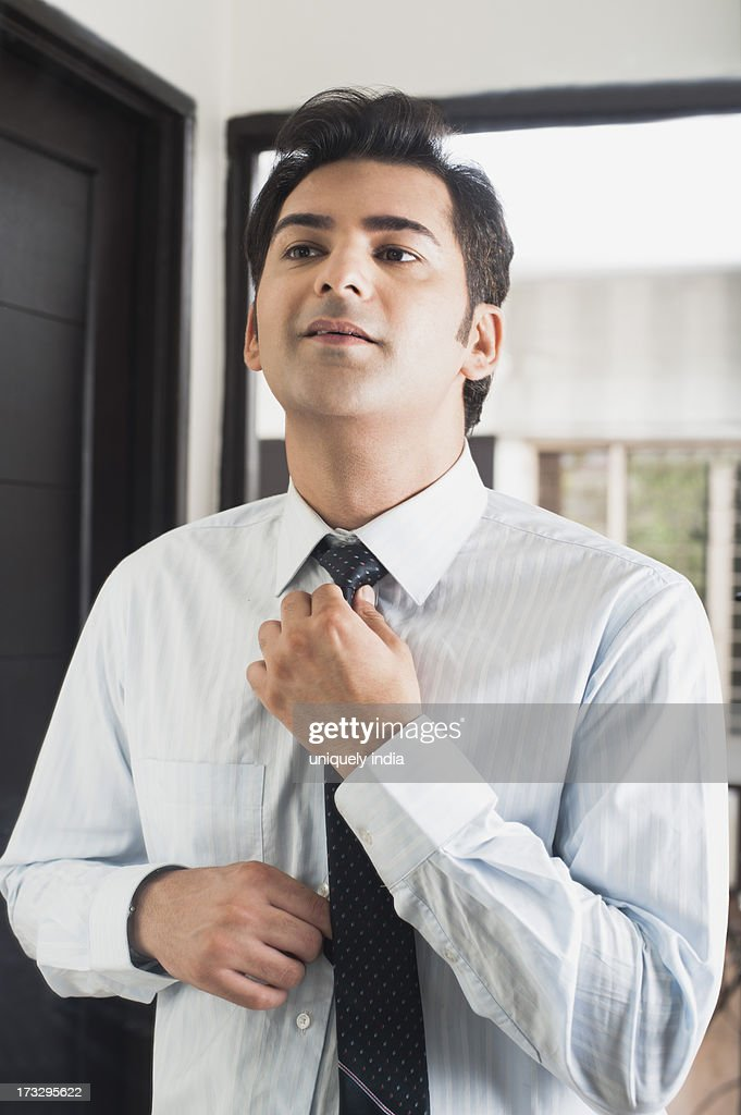 Businessman getting ready for office