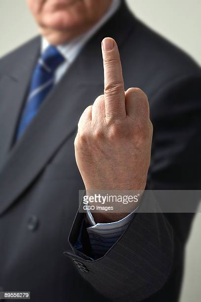 businessman gives one finger salute