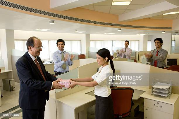 Businessman giving a gift to his staff