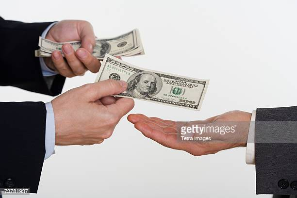 Businessman giving money to a man