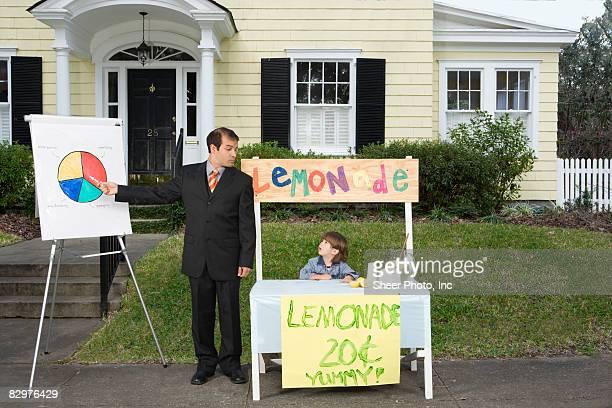 businessman giving presentation at lemonade stand